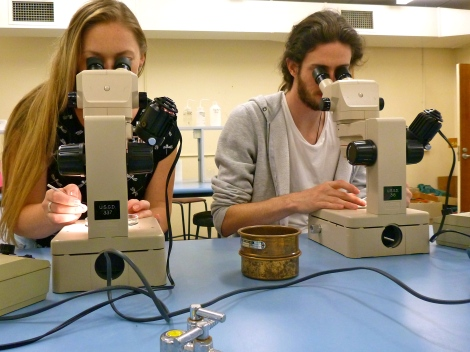 Allison and Tommy looking into the microscopes searching for foraminifera